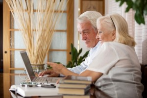 older-couple-on-computer on volunteer screening blot