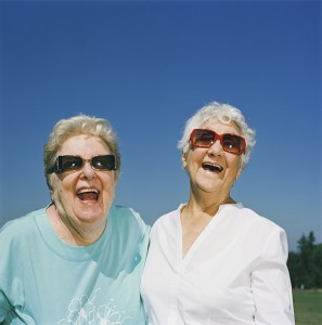 older-volunteers-laughing on volunteer screening blog