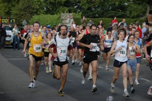 runners-at-the-start-of-race on volunteer screening blog